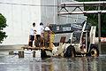 FEMA - 35689 - Workers travel thorugh flood waters by tractor in Iowa.jpg