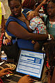 FEMA - 37730 - Residents check in for evacuation transportation in Louisiana.jpg