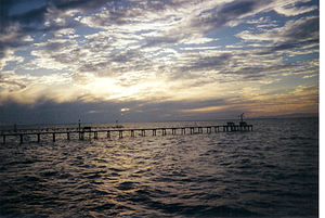 Copano Bay - Piers off the eastern shore of Copano Bay with the shape of the bay on the horizon