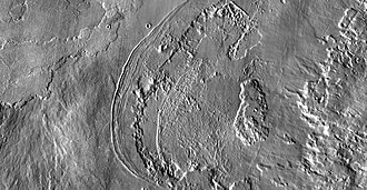 Ascraeus Mons - THEMIS IR daytime mosaic of fan-shaped deposit at western edge of Ascraeus Mons. The deposits are believed to be glacial moraines formed by mountain glaciers.