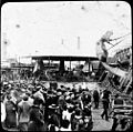 Fairground ride and crowd (6537939543).jpg