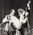 Flaco Jimenez and Peter Rowan (musicians) on stage at Farnham, U.K., 1985.jpg