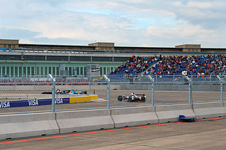 2015 Berlin ePrix - Cars pass through turn ten.