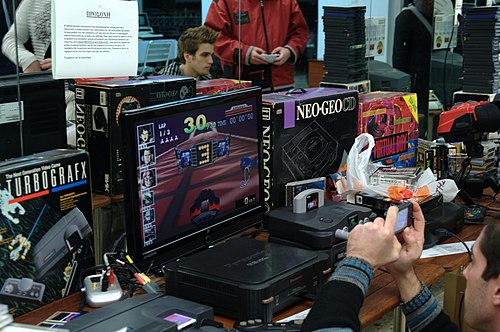 A collection of various video game consoles at a games show Gaming Section 1 - Retrosystems 2010.jpg