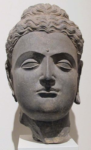 stone bust of Gandhara Buddha from the 1st-2nd century AD