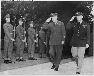 History of the Scots Guards (1914–1945) - General George Marshall, the U. S. Army Chief of Staff, and General Henry H. Arnold, Commanding General of the U. S. Army Air Forces return the salute of the Guard of Honor formed by a detachment of Scots Guards of the British Brigade of Foot Guards, July 1945.