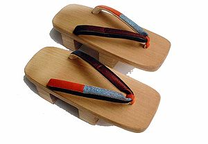 Jjokbari - A pair of Japanese traditional footwear, geta. Unlike traditional Korean footwear, geta separate the big toe from the other four toes.