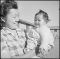 Granada Relocation Center, Amache, Colorado. Mrs. Kobayashi and the youngest of her family. - NARA - 539089.tif