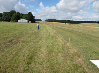 The grass airstrip on the Badminton estate, Badminton, South Gloucestershire, England. The strip is very simple: no lighting, no centreline, and no approach aids. The edge is marked by simple posts. Grass airstrip at badminton england arp.jpg
