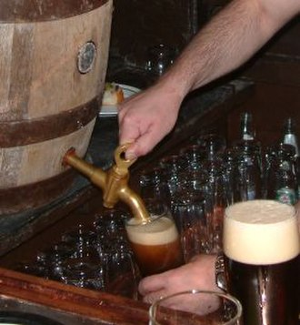 Beer - Schlenkerla Rauchbier, a traditional smoked beer,  being poured from a cask