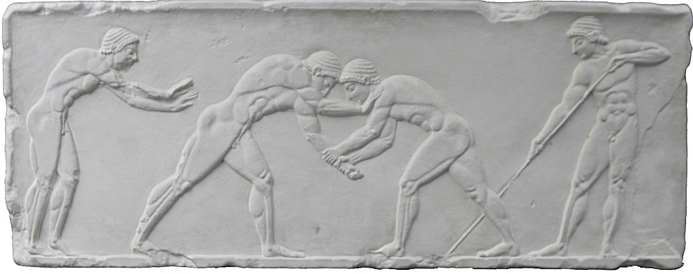 Wrestlers take centre stage on an Ancient Greek relief of the pentathlon, 500 BC. To the left is a sprinter in the starting position, and to the right is a javelin thrower adjusting his grip. Greek relief of pentathlon 500 bC.jpg