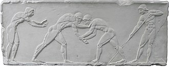 Wrestling - Wrestlers take centre stage on an Ancient Greek relief of the pentathlon, 500 BC. To the left is a sprinter in the starting position, and to the right is a javelin thrower adjusting his grip.