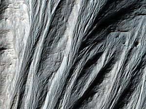 Gullies on Mars - Gullies in the southern highlands of Mars, south of Argyre Planitia. 2014 image from the HiRISE camera on the Mars Reconnaissance Orbiter.