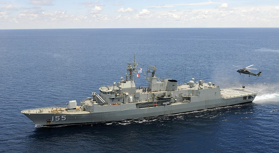 HMAS Ballarat with a US Navy helicopter in 2012