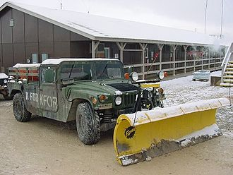 Winter service vehicle - A Humvee with Fisher plow, serving with the United States Army 27th Engineer Battalion in Kosovo