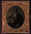 Half-length portrait, young boy seated with flower in lapel. Cased tintype, sixth plate.jpg