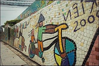 Hanoi Ceramic Mosaic Mural - Mural panel with bicyclist