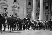 President Harding's casket passes by the front of the White House.