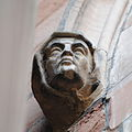 Head at base of a foot moulding at Worcester Cathedral, England.jpg