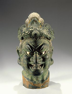 Kamakura period - Head of a Guardian, 13th century. Hinoki wood with lacquer on cloth, pigment, rock crystal, metal. Before entering most Japanese Buddhist temples, visitors must pass large and imposing sculptures of ferocious guardian figures whose role is to protect the premises from the enemies of the religion. The aggressive stances and exaggerated facial features of these figures stand in sharp contrast to the calm demeanor of the Buddha enshrined inside. Brooklyn Museum