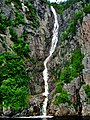 High and thin waterfall flowing into sea - panoramio.jpg