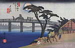 Hiroshige, Man on horseback crossing a bridge.jpg