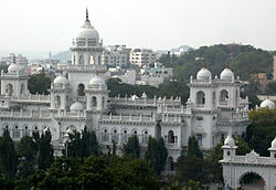 White building with multiple domes