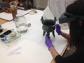 Objects conservator - Laura Kubick treats an object at the Indianapolis Museum of Art