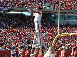 Iowa State University Cyclone Marching Band - A drum major on a ladder conducts the band between plays at a Jack Trice Stadium home game