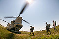 Indian and U.S. paratroopers load a CH47 Chinook helicopter for a training jump at Fort Bragg, N.C. in 2013.jpg