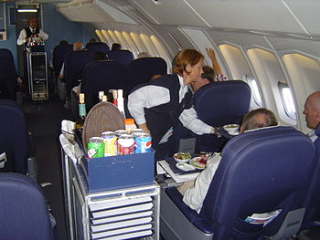 English: inflight service by a stewardess