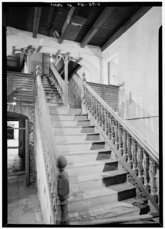 Main staircase from first floor note cast iron columns beneath arch