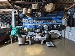 Interior view of a submerged kitchen in the muddy water of the Mekong, at night, during a flood in Don Det, Laos.jpg