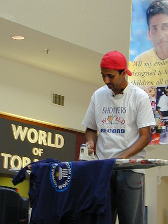 Guinness World Records - Suresh Joachim Arulanantham is a Tamil Canadian film actor and producer and multiple-Guinness World Record holder who has broken over 50 world records set in several countries in attempts to benefit the underprivileged children around the world. Some world record attempts are more unusual than others: he is pictured here minutes away from breaking the ironing world record at 55 hours and 5 minutes, at Shoppers World, Brampton.