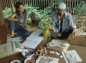 Joyce White - Joyce White and Lung Li look over gathered plant specimens in 1981.