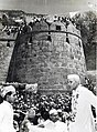 Jawaharlal Nehru being greeted by Gudolia Lohars, Chittor Fort, April 1955.jpg