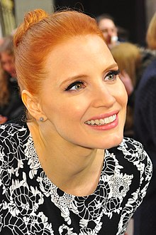A head shot of Chastain as she looks away from the camera