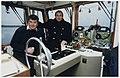 John Huismans en (r) Ton Bussen op de pont over het Noordzeekanaal. NL-HlmNHA 54050179.JPG