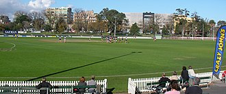 Junction Oval - A VAFA match featuring Old Melburnians at the Junction Oval looking towards Fitzroy Street from the hill on the outer