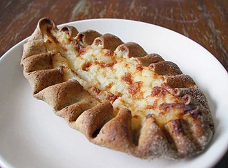Karelian pasty (karjalanpiirakka) is a traditional Finnish dish made from a thin rye crust with a filling of rice. Butter, often mixed with boiled egg (eggbutter or munavoi), is spread over the hot pastries before eating. Karjalanpiirakka-20060227.jpg