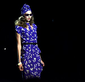 Retro style - A 1940s retro-style dress with turban, designed in a modern electric blue, modeled by Karlie Kloss at a 2011 Anna Sui show