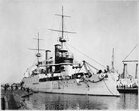 Kearsarge (BB5), converted to craneship in 1920. Port bow, at wharf, 09-18-1899 - NARA - 535431.jpg