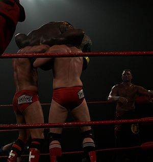 The Kings of Wrestling - Hero and Castagnoli performing a double suplex on Shelton Benjamin.