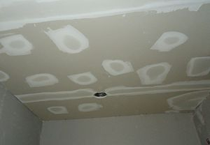 Spackling paste - Kitchen renovation spackling to cover holes and tape between sheetrock boards.JPG