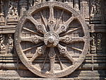 Decorated wheel in stone relief.