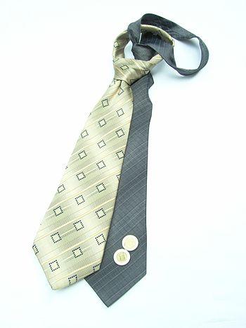 The modern necktie descends from the cravat, a...