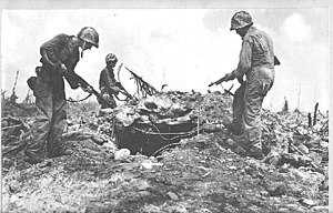 Kwajalein Atoll - U.S. Infantry inspect a bunker after capturing the Kwajalein Atoll from Japan during World War II
