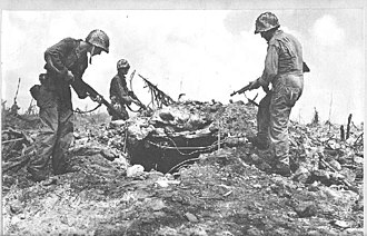 Kwajalein Atoll - U.S. infantry inspect a bunker after capturing the Kwajalein Atoll from Japan during World War II.
