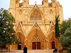 The Lala Mustafa Pasha Mosque in Famagusta (Gazimağusa). Formerly Τhe Saint Nicolas Cathedral prior to its conversion in 1571. Tourism remains an important source of revenue for Northern Cyprus.