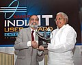 Lalu Prasad accepts a special award 'IT Transformation Award', on behalf of Indian Railways for pioneering use of technology by the Indian Railways, from the President, NASSCOM, Shri Kiran Karnik.jpg